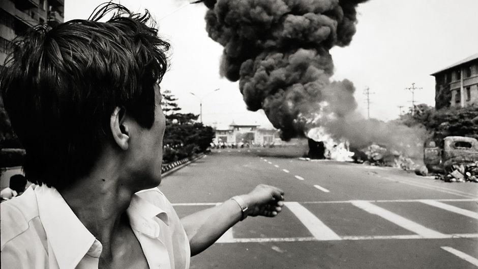 smoke-rises-from-a-burning-car-during-a-riot-near-tiananmen-squ-data
