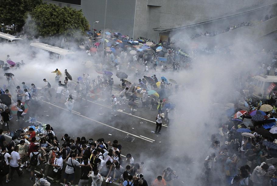 1411910466260_wps_29_Riot_police_use_tear_gas_
