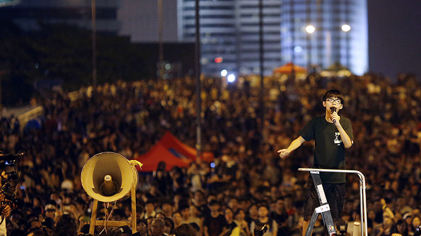 Joshua Wong, leader of the student movement, delivers a speech as protesters block the main street to the financial Central district in Hong Kong